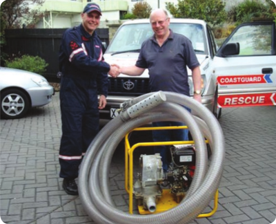 Vero Marine's Lindsay Ross presents the diesel salvage pump to Coastguard Mana